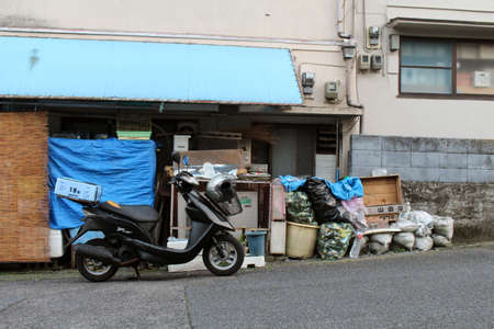 Motorcycle and stuff in front of a house or shop in Beppu, Oita, Japan. Taken in June 2019. Redakční