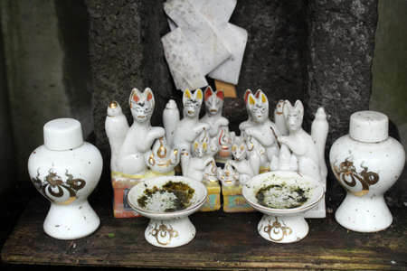 Cat figurines at a Shinto altar for worship.