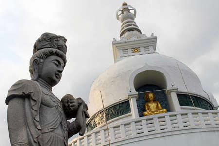 The statue of Kanon or Guanyin and stupa at Myohoji temple in Beppu, Japan. Taken in June 2019.
