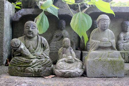 Statue of Buddha and Jizo at a Japanese temple.