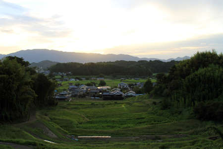 Sunset, paddy field, and traditional houses in Asuka village. Taken in September 2019. Stock Photo