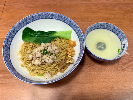 Indonesian Chicken noodle or mi ayam with bok choy. Stock Photo