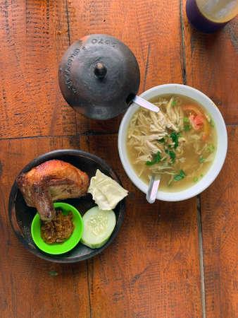 Indonesian Javanese yellow chicken soup soto ayam with ayam penyet