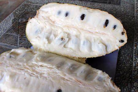 Fresh slice of soursop or sirsak and its seed.