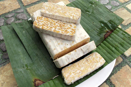 Slices of Indonesian tempe or tempeh, an alternative healthy vegan food.