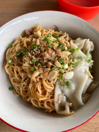 Indonesian Chicken noodle or mi ayam with wonton. Stock Photo