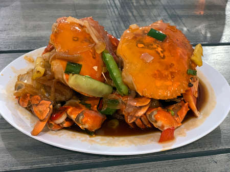 Indonesian sweet sour crab served on a plate. Stock Photo
