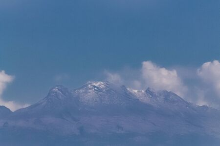 View of the iztaccíhuatl volcano. No snow in winter time. Global warming Stock Photo - 140608844