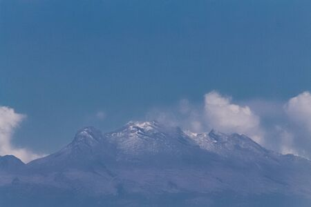 View of the iztaccíhuatl volcano. No snow in winter time. Global warming Stock Photo - 140608820
