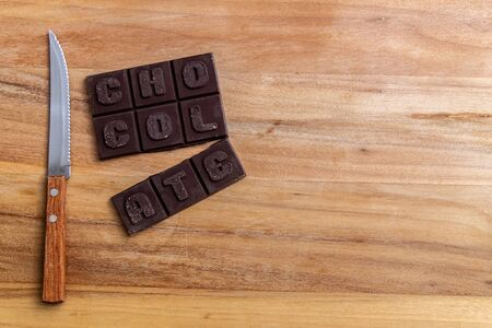 Chocolate bar on wooden cutting board. Mexican traditional sweet