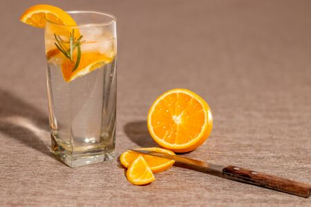 natural orange drink with rosemary in cold tones 版權商用圖片