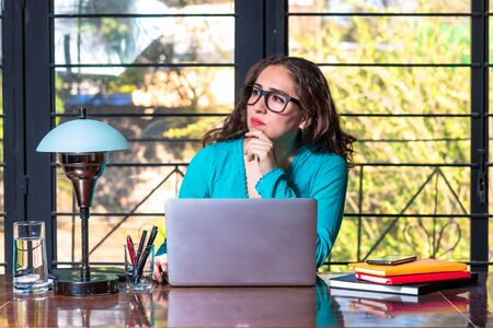 Real woman working from home. Hipster girl working in home office. beautiful brunette