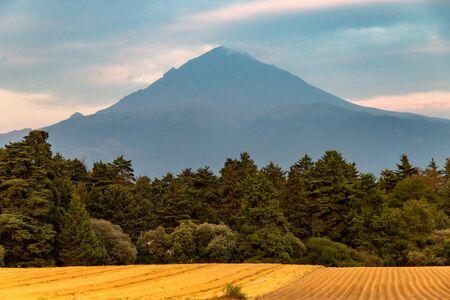 Scene from the Iztaczihuatl and Popocatepetl volcano. On a sunset.