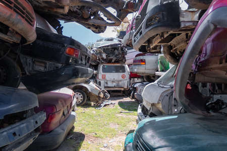 Old damaged cars on the junkyard waiting for recycling in Mexico City. Mexico