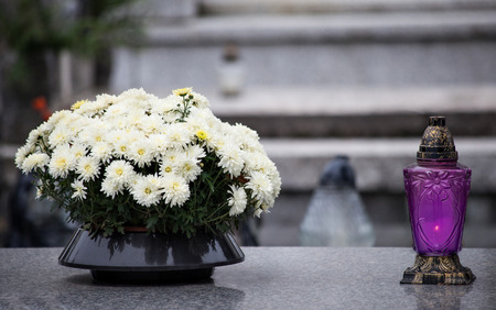 life after death: Candle at a cemetery Stock Photo