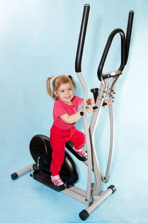 Little girl in a sports simulator. Stock Photo - 6185913