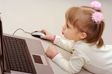Little girl with laptop. Stock Photo - 6185914
