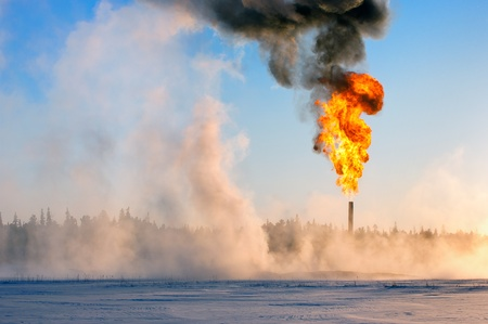 Gas flaring. Oil production in Western Siberia. Evaporation of snow. Stock Photo