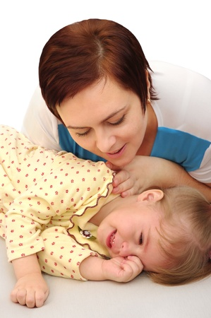 Mom comforts her little daughter crying. photo