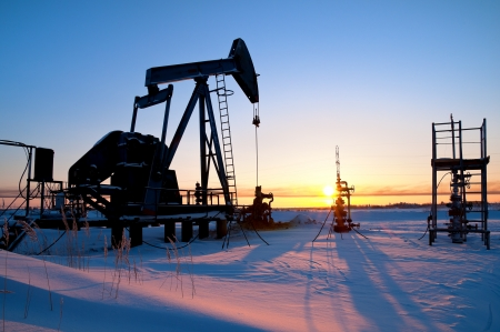 oil tool: Oil pump. Industrial landscape. Extraction of oil in Western Siberia. Stock Photo