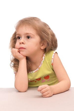 Thoughtful little girl. Portrait of a 3 year old girl. Stock Photo