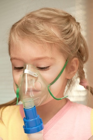 inhalation: A little girl three years doing inhalation