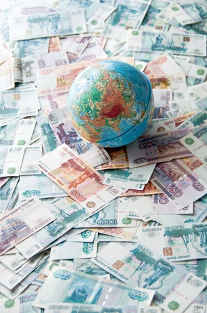 Globe on Russian money. Globe lies on the Russian ruble different denominations photo