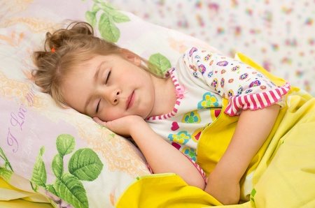 Sweet Dream. Little girl asleep with a smile on your face Standard-Bild
