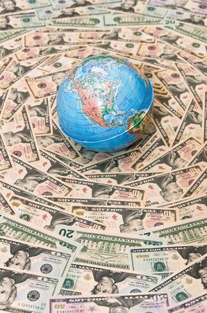 Background of the money. The background of U.S. dollars. Globe in U.S. dollars. Global Economy Stock Photo
