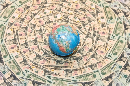 Background of the money. The background of U.S. dollars. Globe in U.S. dollars. Global Economy Stock Photo