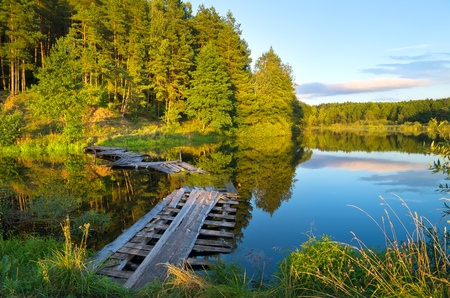 Colorful landscape with a wooden bridge over the river