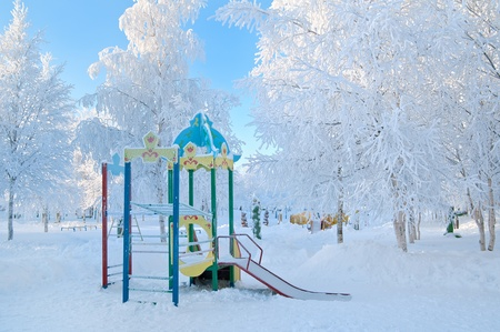 frost covered: Playground in a kindergarten in the winter. Stock Photo