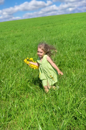 The little girl ran across the field with a wreath of flowers