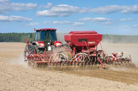 mechanization: Tractor working in the field.