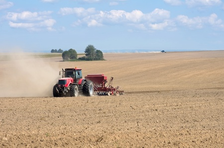seed drill: Time of sowing. Planting crops. The warm sunny weather. Stock Photo