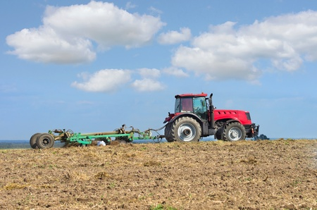 seed drill: Tractor with cultivator handles field before planting