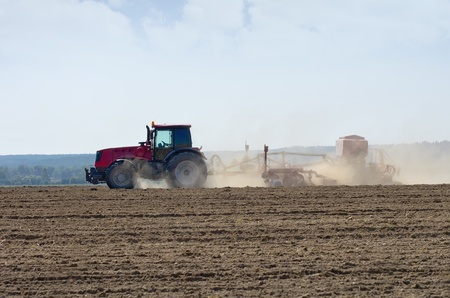 seed drill: Tractor working in the field.
