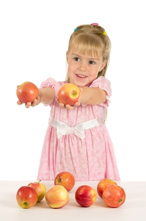 Cheerful girl holding a delicious apple. Healthy Eating Stock Photo - 10939131