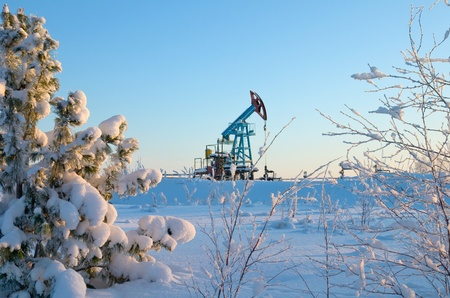 drilling well: The oil pump. Siberian frosty morning.