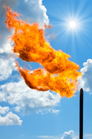 gas fire: Gas flaring  Torch against the sky  Stock Photo