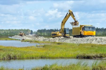 Oil pipeline construction on the marshland