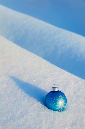 drifts: Christmas ball on the snow drifts