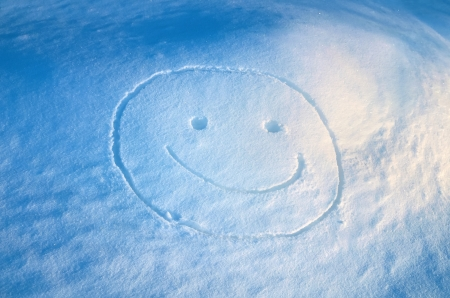 snowbank: Cheerful smiley on snowbank Stock Photo