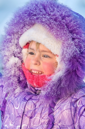 Portrait of a naughty girl with frozen eyelashes closeup Stock Photo - 17076413