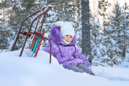 The little girl on a walk in the winter woods Stock Photo - 17108957