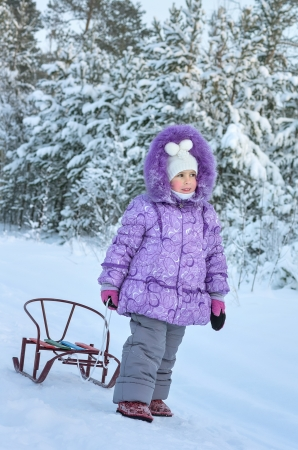 Little girl walking in winter forest Stock Photo - 17125231