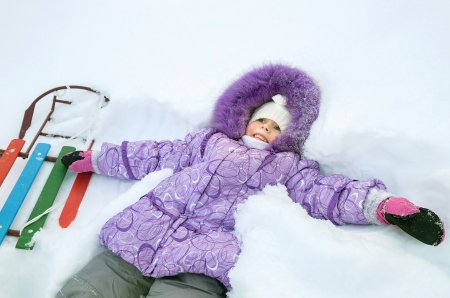 Little girl lying in deep snow Stock Photo - 17154462