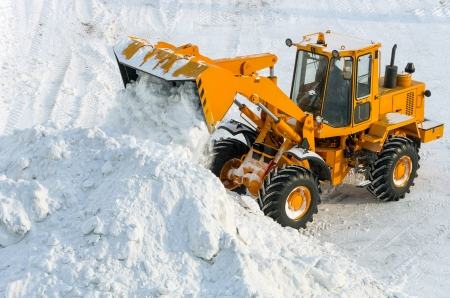 loader: Clearing the road from snow