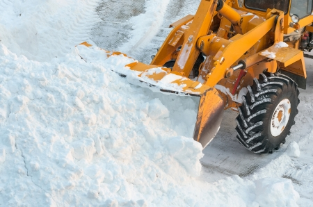 heap of snow: Clearing the road from snow