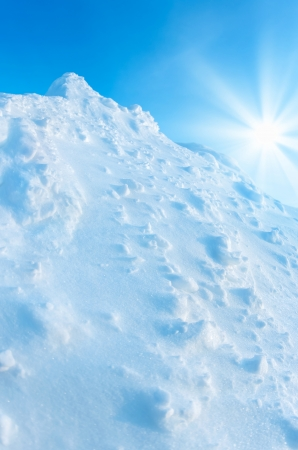 Snow Mountain on a background of blue sky photo